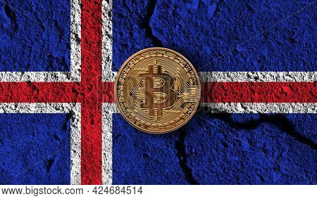 Bitcoin Crypto Currency Coin With Cracked Iceland Flag. Crypto Restrictions