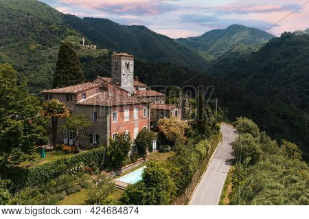 House or cottage in the middle of summer with a beautiful garden and swimming pool in Tuscany. The place is romantic and makes you dream. The shot was done with a drone. Italy always beautiful