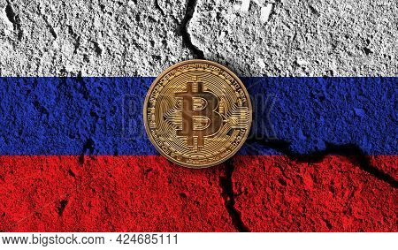 Bitcoin Crypto Currency Coin With Cracked Russia Flag. Crypto Restrictions