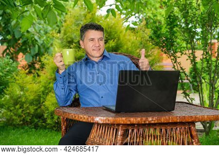 Smiling Mature Caucasian Man Drinking Coffee And Showing Thumb Up With Fingers To Business Partner V