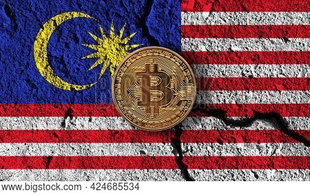 Bitcoin Crypto Currency Coin With Cracked Malaysia Flag. Crypto Restrictions