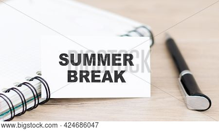 Text Summer Break On A White Card On The Table Next To A Notepad And Pen. Local Tourism, Lockdown Va