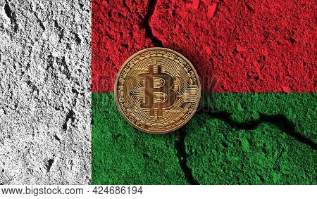 Bitcoin Crypto Currency Coin With Cracked Madagascar Flag. Crypto Restrictions