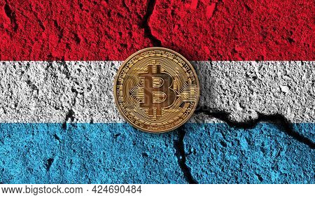 Bitcoin Crypto Currency Coin With Cracked Luxembourg Flag. Crypto Restrictions
