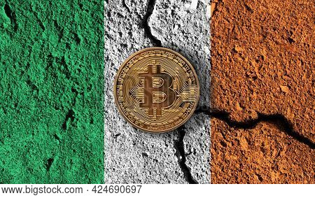 Bitcoin Crypto Currency Coin With Cracked Ireland Flag. Crypto Restrictions