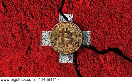 Bitcoin Crypto Currency Coin With Cracked Switzerland Flag. Crypto Restrictions