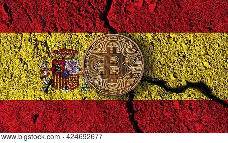 Bitcoin Crypto Currency Coin With Cracked Spain Flag. Crypto Restrictions
