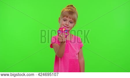 Girl Playing, Spinning With Pop It Sensory Anti-stress Toy. Child Kid Presses On Colorful Rainbow Sq