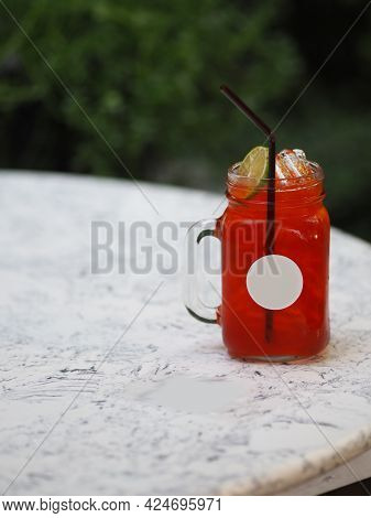 Red Lemon Soda Water Flavoured Drink, Cool Drinks Beverages With Ice In Clear Glass On White Table