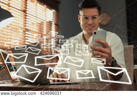 Businessman Sending Emails At Table Indoors, Focus On Hand
