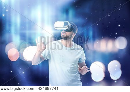 Man Using Virtual Reality Headset And Getting In Simulated Futuristic World