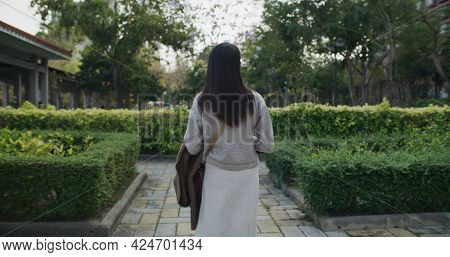 Woman walk in the park
