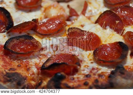 Close Up Of A Crusty Pepperoni And Cheese Pizza