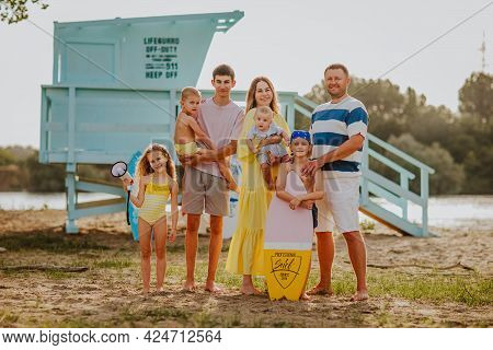 Big Cute Family Of Seven With Newborn Baby Boy, Girl, Boys And Teenager In Yellow Summer Clothes Pos