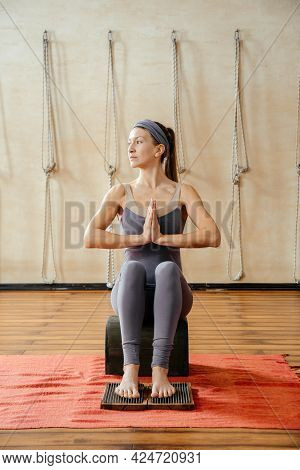 Yoga And Health Concept. Fit Woman Stretching In Yoga Studio With Feet On Sadhu Board With Sharp Met
