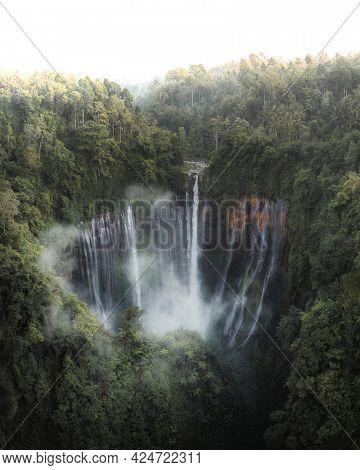 Beautiful Coban Sewu waterfall in Java, Indonesia