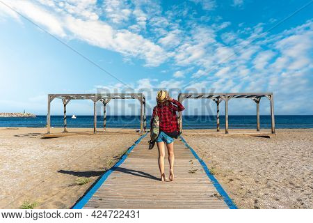 A Young Tourist On The Wooden Walkway Of San Jose Beach In The Town Of Nijar, Almería. Andalusian Co