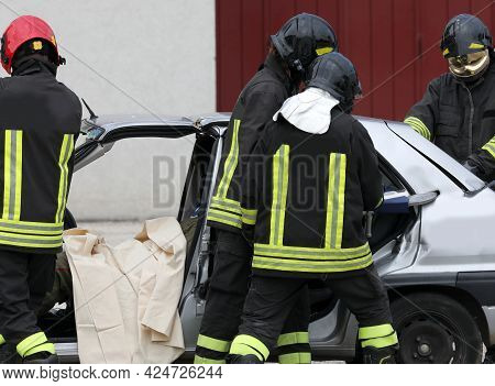 Firefighters During The Rescue After The Road Accident
