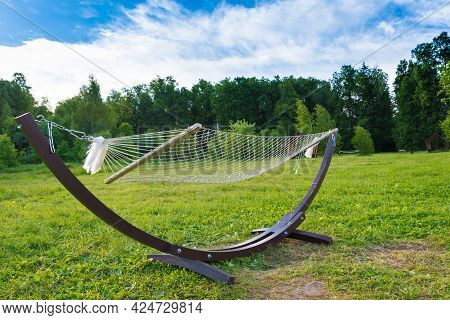 Hammock Close-up. The Concept Of Vacation, Summer And Vacation. A Hammock Against A Bright Blue Sky