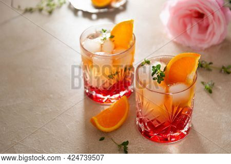 Summer Drink With Strawberries, Oranges And Fresh Herb, Delicious Homemade Lemonade Glasses With Syr