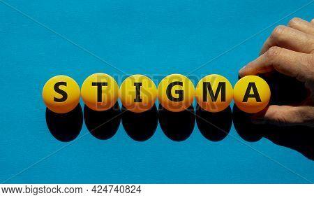 Medical And Stigma Symbol. The Concept Word 'stigma' On Orange Table Tennis Balls On A Beautiful Blu