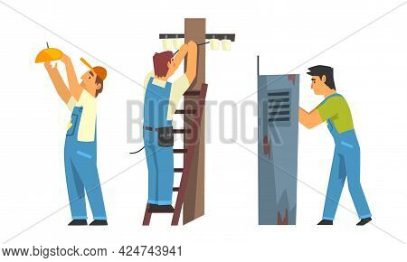 Man Electrician In Blue Overall With Professional Tools Engaged In Maintenance And Repair Electrical
