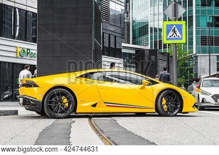 Moscow, Russia - June 2021: Lamborghini Huracan Parked On The Street In Moscow. Yellow Supercar In F