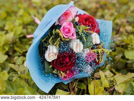 Wedding Decorative Bouquet Of Roses Flowers On A Background Of Green Foliage.