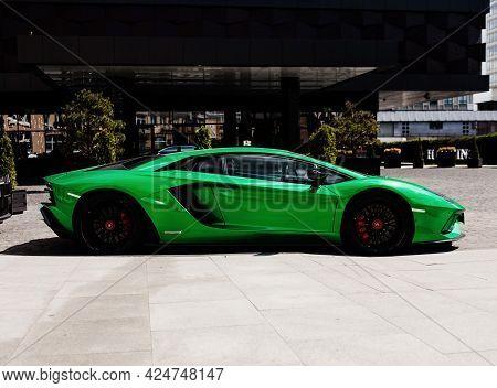 Minsk, Belarus-june 2021: Lamborghini Aventador Supercar On The Background Of The Expensive Hilton H
