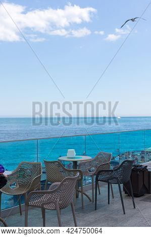 June, 2021. The Resort City Of Yalta, The Black Sea Coast. City Embankment, Street Cafe Above The Se
