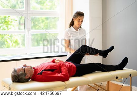 Physiotherapist Knee Treatment And Physical Therapy For Old Man