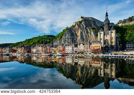 View of picturesque Dinant town, Dinant Citadel and Collegiate Church of Notre Dame de Dinant over the Meuse river. Belgian province of Namur, Blegium