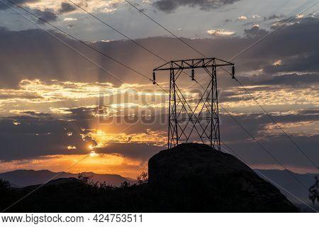 Electric power pylon sunrise at Santa Susana Pass State Historic Park in Los Angeles County, California.
