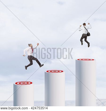 businesspeople jumping from one goal to another. business success concept.