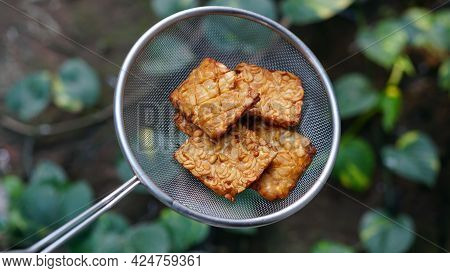 Tempe Or Tempeh After Frying Put In Colander. Focus Selected, Background Blur