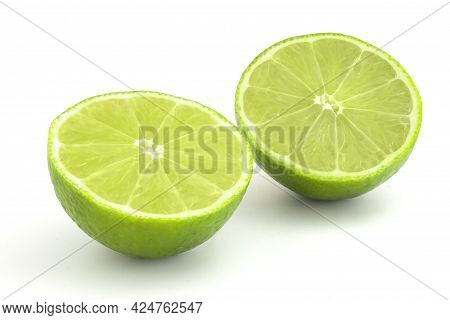 Lime In Section Isolated On White Background. Ripe Green Citrus For Cocktails And Alcoholic Beverage