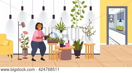Woman With Watering Can Taking Care Of Houseplants Girl Caring For Indoor Plants Stay Home Lifestyle