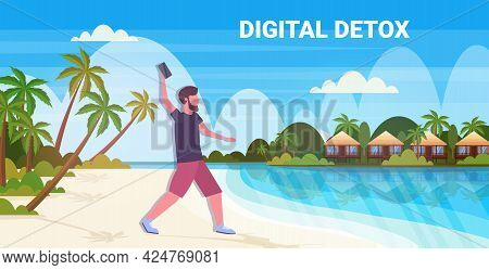 Man Throwing Away Smartphone Digital Detox Concept Guy Relaxing On Tropical Beach Abandoning Gadgets