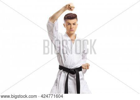 Guy in kimono exercising block technique in martial arts isolated on white background