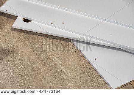 Board Chipboard Cut Parts On Parquet Floor, Copy Space