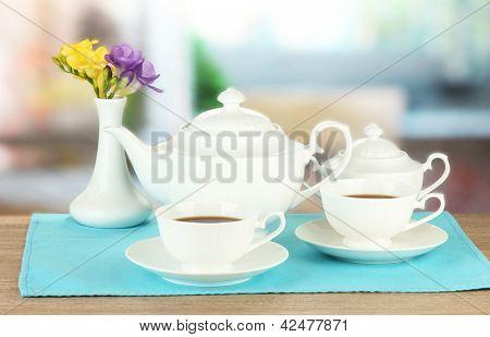 Beautiful tea service on wooden table