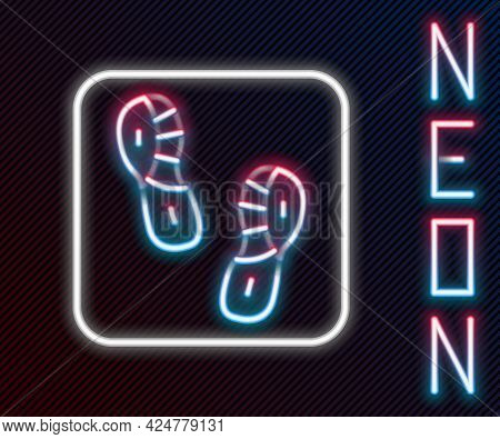 Glowing Neon Line Human Footprints Shoes Icon Isolated On Black Background. Shoes Sole. Colorful Out