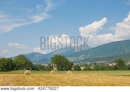 Viw Of Typical Summer Umbria Landscape With Hay Balls In Gualdo Tadino