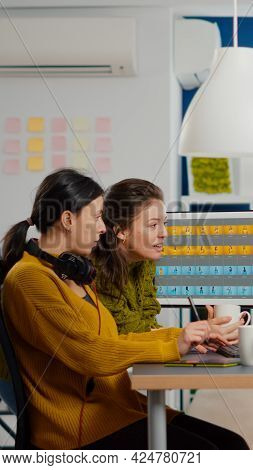 Art Director Consulting Designer Colleague, Retouching Portrait In Photo Editing Software Working In