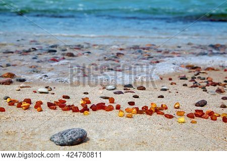 Amber On The Seashore. Raw Amber By The Sea. Sun Stone