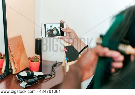 Asian Girl Making Selfie While Hairdresser Comb Her Hair.  Woman And Hairdresser With Protective Mas