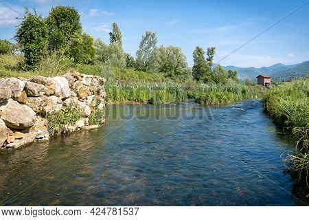Dam, River And Small Waterfalls Near A Road In Province Of Fronzinone In Italy