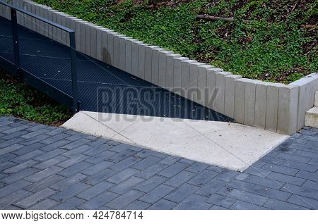 Ramp Combined With A Staircase Made Of Gray Concrete And A Railing Specially Adapted For Wheelchairs