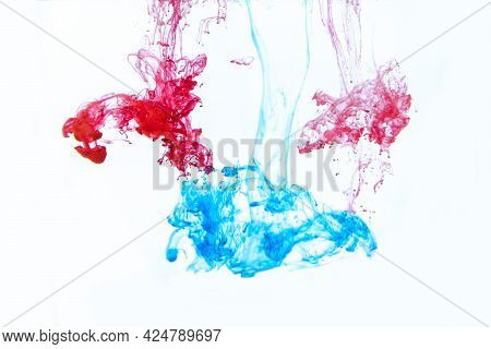 Blue And Red Watercolor Ink In Water Shot With High Speed Camera And Flowing Downward. Paint Movemen