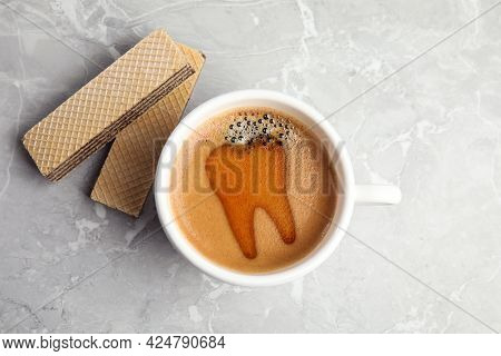 Coffee Causing Dental Problem. Cup Of Hot Drink And Wafers On Grey Marble Table, Flat Lay